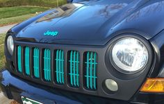 Tiffany Blue and black Jeep Liberty. Turquoise Jeep grille.