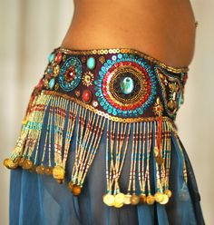 Perfectly Beautiful Belly Dance belt beaded sequined in maroon red turquoise and gold. $165.00, via Etsy.