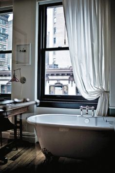 NoMad Hotel in NYC.great window trim, simple drapery, wood floor and clawfoot tub Bad Inspiration, Bathroom Inspiration, Bathroom Interior, Modern Bathroom, Design Bathroom, Classic Bathroom, White Bathroom, Nomad Hotel Nyc, Decoration Home