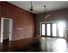 remarkable red brick accent wall and I love the color on the other wall!