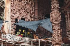 The Sanctuary of Truth, Pattaya Thailand isjustmejc wrote: The majestic wooden sculptures inside the Sanctuary of truth in Thailand. The sculptures consists of Khmer, Myanmar, Thai, China, Indian and...