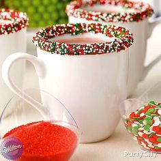 May your mugs be merry and bright! Sweeten up mugs at your cocoa station by drizzling melted candy on the rims and dipping in sprinkles.