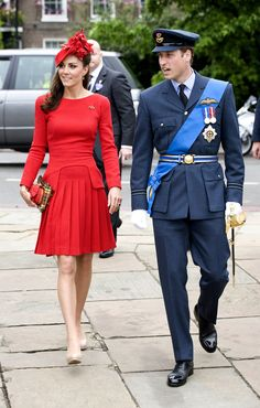 June Kate attends Queen Elizabeth's strong Diamond Jubilee river pageant with Prince William and the royal family. Kate is wearing a red suit dress made by Sarah Burton at Alexander McQueen, shoes by LK Bennett and carrying an Alexander McQueen clutch.