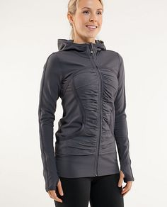Love!   key features  made with soft, moisture wicking luon  long length covers your rear and is great for layering over running tights  keep your hands warm in the Circle-Mesh-lined pockets  thumbholes keep sleeves down and wrists warm  the zipper garage keeps your chin from getting chafed  chafe-resistant flat seams throughout won't rub you the wrong way  hide from the chill in the deep hood  don't scrounge around for a rubber band, your emergency hair tie is on the zipper  tech specs…