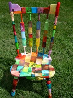 Functional art - amazing. I want to do something in my kitchen. He has 3 other chairs... all painted differently.