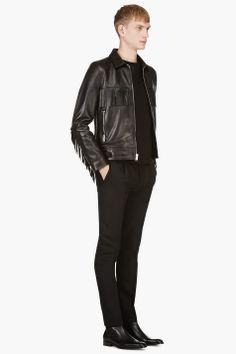 SAINT LAURENT Black Leather Classic Fringed Jacket / Styled with SAINT LAURENT Black Crewneck Leather Trim Sweatshirt, SAINT LAURENT BLACK PLEATED Classic TROUSERS, SAINT LAURENT Black Leather Chelsea Boots.