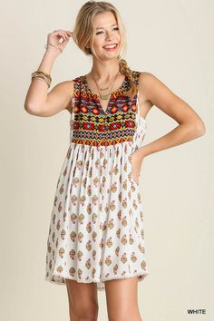 Bohemian printed baby doll tunic dress with a contrast mixed media at the chest and the back. Stylish and comfortable for any day. Content + Care: 65% Cotton 35% Polyester Hand Wash