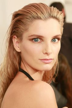 From poker-straight hair to rebellious black eyeliner, see the most prominent beauty trends from the spring/summer 2014 shows Combed Back Hair, Swept Back Hair, Wet Look Hair, Hair Looks, Straight Hairstyles, Braided Hairstyles, Spring Summer Trends, Summer 2014, Runway Hair