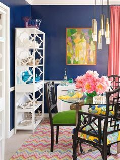 BOLD,but beautiful...Navy dining room with pink green etc