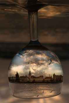 Amazing photo of a city in an upisde down glass, the city in the glass looks so cool.