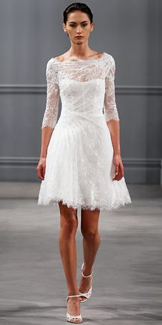 Silk white Chantilly lace bateau neck three quarter sleeve draped dress with appliquéd re-embroidered lace.