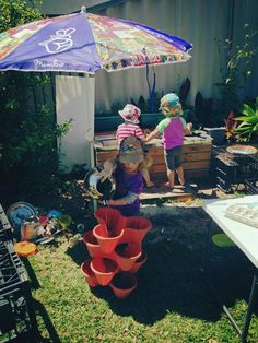 """Loving how these interesting buckets (planters?) have been stacked for water play at Wholesome Beginnings ("""",) Construction Area, Play Yard, Outdoor Learning, Water Play, Play Ideas, Preschool Kindergarten, Buckets, Homeschooling, Planters"""