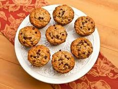 Easy, Healthy Banana Oatmeal Muffins  2.5 cups oats, 1 cup plain greek yogurt, 2 eggs , 1/2 cup sugar , 1 1/2 tsp baking powder ,1/2 tsp baking soda, 2 bananas.    Heat oven to 400. Combine ingredients and pour into muffin tin. Bake for 15-20 minutes.    http://nateandrachael.com/healthy-banana-oatmeal-muffins/