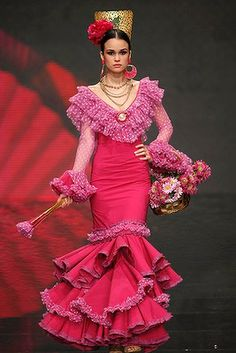 A model presents a creation by David Alvarez & Purificacion Ramos during the International Flamenco Fashion Show SIMOF in the Andalusian capital of Seville.