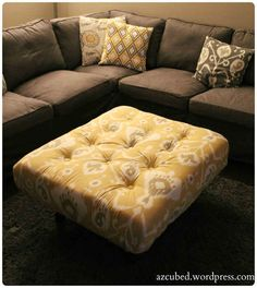 Cover an old pallet with foam, batting, and fabric for a custom living room ottoman.