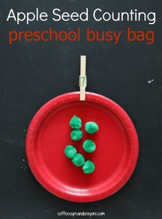This apple seed counting busy bag is perfect for preschool kids who are working on numbers, counting, and one-to-one correspondence.