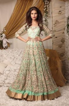 Pale green feminine, flowing and voluminous gown-type lehenga