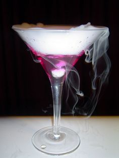 Color-Changing Martini: Changes from a calm blue to fuschia as it cools room temperature to drinkable cold, taste like a dirty martini: