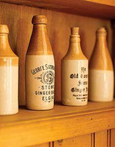 Home decorating antique furniture - Ginger Beer Bottles