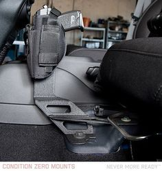 The Condition Zero 4 Door JK Unlimited Pistol Mount bolts directly into the seat bracket bolts. Powdercoated black.  Note:– Driver Side Only       – Only fits 4-door JK's       – Holster Not Included