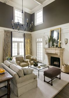 Great contrast white walls, charcoal ceiling ?, gold window treatments, light and dark contrast for floors and furnishings.