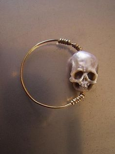 OBSESSED.  hand carved pearl skull ring.