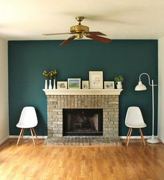 Fireplace accent wall complements painting. | Interior Design ...