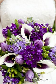 We LOVE this use of color in the bridal bouquet.  Look outside the box when choosing yours! #weddingflowers