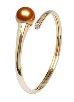 Cuff bangle in 18k gold with a golden pearl and diamond accent; $7,725; Jewelmer, Scottsdale, Ariz.