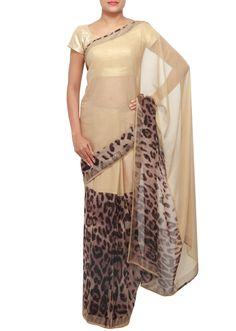 Simple cream colored and leopard print saree.