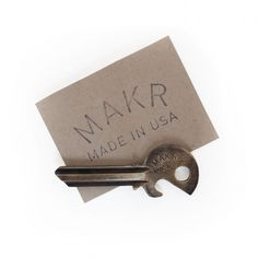 MAKR Bottle Key - MAKR's Bottle Key ingeniously combines a brass blank key with an opener, unlocking doors and bottles alike. No more borrowing lighters, and no more bulk on your keyring.