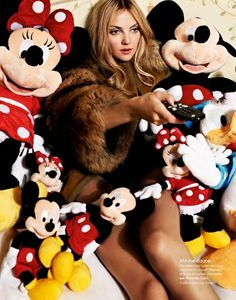 Elle France's Fashion Parade in Disneyland! (Editorial) - Heather Marks in Carven & Givenchy in a bed of Mickey and Minnie stuffed toys!