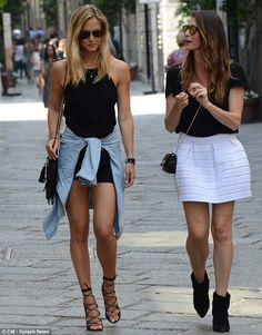Can that frock get any shorter? Israeli supermodel Bar Refaeli flashed her long legs in bl...