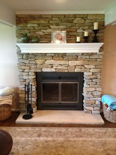 The new refaced fireplace with new fireplace doors and custom mantel.