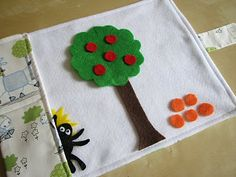 Felt Travel Mat for the little ones.  Perfect to take out to eat to keep them busy while waiting on your food...