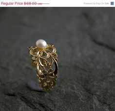 Check out this item in my Etsy shop https://www.etsy.com/listing/177905415/summer-sale-pearl-wedding-ring-lace-gold
