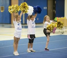 Girls participate in a cheerleading camp at Eastside High School.
