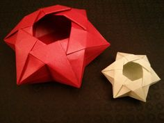 Paper: 8 inch hexagon of stardream, 4 inch hexagon of skytone Designer: Francis Ow Book: The Origami Bible (Nick Robinson) Folding time: about 10 minutes
