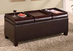 Durable leather-like vinyl storage ottoman with three trays.