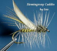 """According to Steve Schalla, """"the Hemingway Caddis is a variation of the Henryville, developed by Mike  [and Sheralee] Lawson, with a Peacock Thorax and a Blue Dun Hackle for both the collar hackle and the palmered rib. It was named for Jack Hemingway, son of Ernest Hemingway, who preferred this variation when he fished the Henry's Fork in Idaho because he thought the Henryville Special was a little too brown in coloration.""""   stevenojai.tripod.com/hemingway.htm"""
