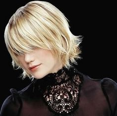 trendy short hair in layers with long bang.jpg