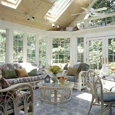 Sunroom Decorating - smart to put partial roof over side with max afternoon sun and instead to put sky lights in.