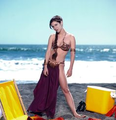 CARRIE FISHER as Princess Leia, fooling around off set on the beach. size photo on gloss paper. Princess Leia Bikini, Star Wars Princess Leia, Princess Leia Cosplay, Princess Leia Slave, Star Wars Poster, Star Wars Art, Star Trek, Star Wars Girls, Star Wars Pictures