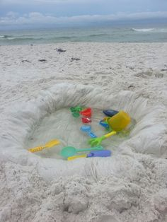 Toddler pool idea I came up with when we couldn't find a baby pool at the beach... Clear shower curtain liner $3.00 Dig a shallow hole..my husband and his friend submerged the shower curtain in the ocean water then brought it back to the hole. you can also use sand buckets to fill..my husband also dug a trench on the outside of the hole so we could tuck in the corners and border of the left over shower curtain..then packed the top with sand..it kept the kids from pushing the border into the…