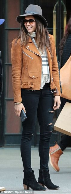 Keeping it casual: The 27-year-old was pictured beaming broadly as she rocked a laid back look