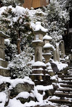 Stone lanterns at Todaiji temple, Nara, Japan - There's something magical about the idea of a snowy mountain in Japan