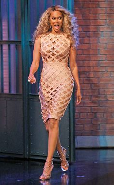In the Flesh from Fashion Police  Tyra Banks goes nude in an eye-popping House of CB cage dress for an appearance on The Late Show With Seth Meyers. The supermodel's cutout number flashes her flesh-colored undergarments, proving this look is definitely not for the faint of heart. The America's Got Talent host styles her bombshell ensemble with gold Giuseppe Zanotti sandals, voluminous curls and an unnecessary necklace.