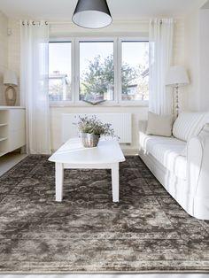 Der elegante Orientteppich Vintage Flowers von benuta versprüht mit seinen filigranen Blumen-Mustern im Vintage-Stil den Charme eines alten Erbstücks.