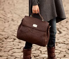 Long grey coat, jeans, strappy/ clunky brown boots  and a patterned leather bag -gorgeous~