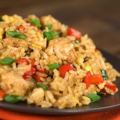 The next time you're tempted to get fattening fried food, pick up the ingredients yourself and cook our Clean Eating Chicken Fried Rice instead.